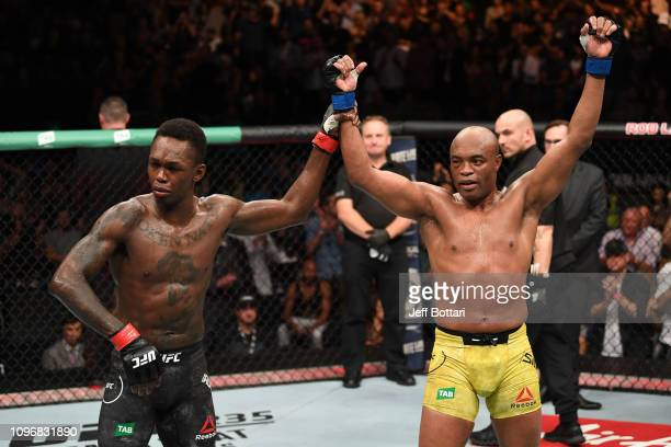 Anderson Silva of Brazil and Israel Adesanya of New Zealand react after the conclusion of their middleweight bout during the UFC 234 at Rod Laver...