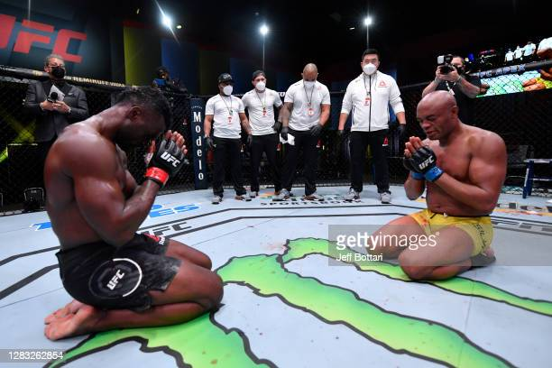 Anderson Silva of Brazil and Uriah Hall of Jamaica pay each other respect after their middleweight bout during the UFC Fight Night event at UFC APEX...