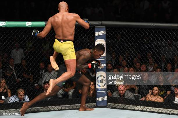 Anderson Silva of Brazil attempts to knee Israel Adesanya of New Zealand in their middleweight bout during the UFC 234 at Rod Laver Arena on February...