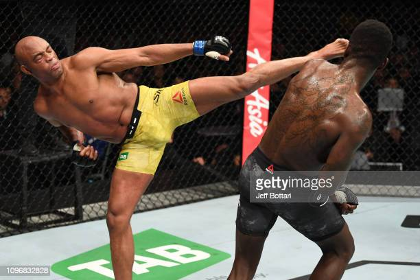 Anderson Silva of Brazil kicks Israel Adesanya of New Zealand in their middleweight bout during the UFC 234 at Rod Laver Arena on February 10 2019 in...