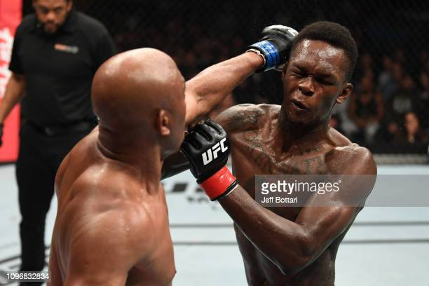Anderson Silva of Brazil punches Israel Adesanya of New Zealand in their middleweight bout during the UFC 234 at Rod Laver Arena on February 10 2019...