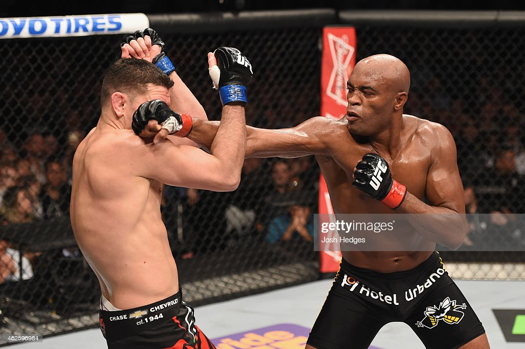 Anderson Silva punches Nick Diaz in their middleweight bout during the UFC 183 event at the MGM Grand Garden Arena on January 31, 2015 in Las Vegas, Nevada.