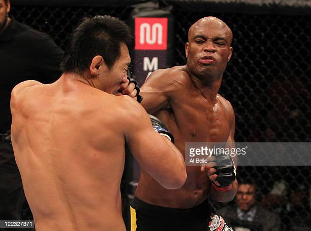 Anderson Silva punches Yushin Okami during the UFC Middleweight Championship bout at UFC 134 at HSBC Arena on August 27, 2011 in Rio de Janeiro,...