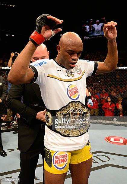 Anderson Silva reacts after knocking out Chael Sonnen during their UFC middleweight championship bout at UFC 148 inside MGM Grand Garden Arena on...
