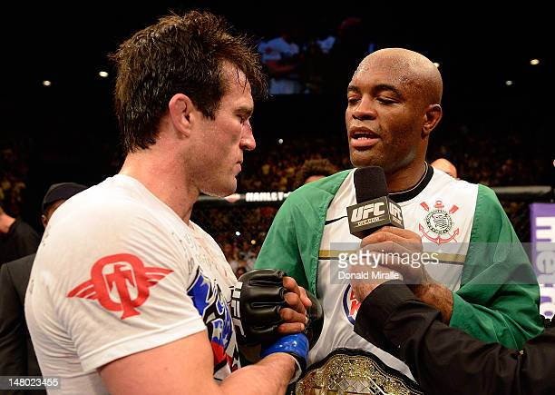Anderson Silva speaks with Chael Sonnen after he defeated him during their UFC middleweight championship bout at UFC 148 inside MGM Grand Garden...