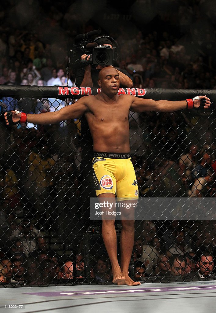Anderson Silva stands in the Octagon before his middleweight championship bout against Chael Sonnen at UFC 148 inside MGM Grand Garden Arena on July 7, 2012 in Las Vegas, Nevada.