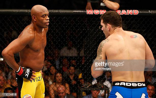 Anderson Silva taunts Chris Weidman in their UFC middleweight championship fight during the UFC 162 event inside the MGM Grand Garden Arena on July 6...