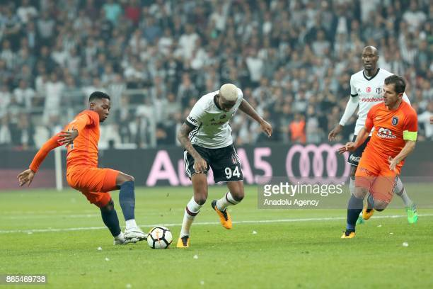 Anderson Souza Conceicao of Besiktas in action against Joseph Larweh Attamah of Medipol Basaksehir during a Turkish Super Lig soccer match between...
