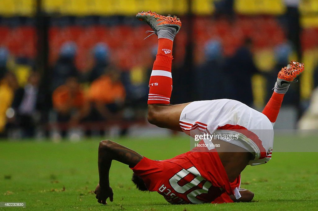 Anderson Talisca of Benfica falls down during a match between America and Benfica as part of the International Champions Cup 2015 at Azteca Stadium on July 28, 2015 in Mexico City, Mexico.