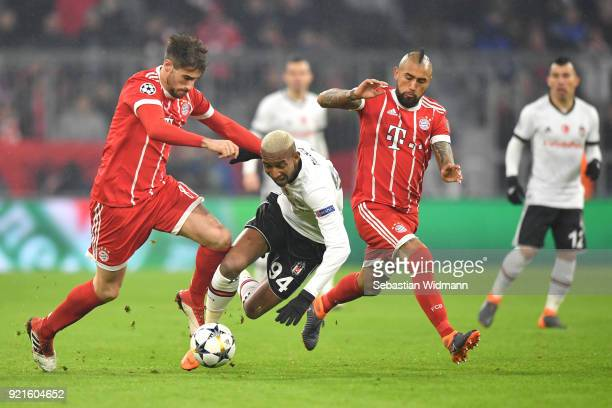 Anderson Talisca of Besiktas is tackled by Javi Martinez and Arturo Vidal of Bayern Muenchen during the UEFA Champions League Round of 16 First Leg...