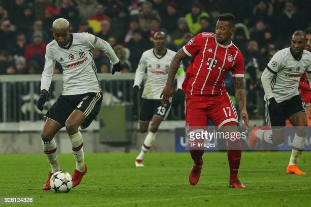 Anderson Talisca of Besiktas Istanbul and Jerome Boateng of Bayern Muenchen battle for the ball during the UEFA Champions League Round of 16 First...