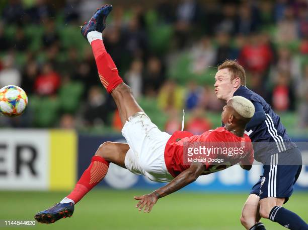 Anderson Talisca of Guangzhou Evergrande attempts a scissor kick for goal against Corey Brown of the Victory during the round 1 AFC Champions League...