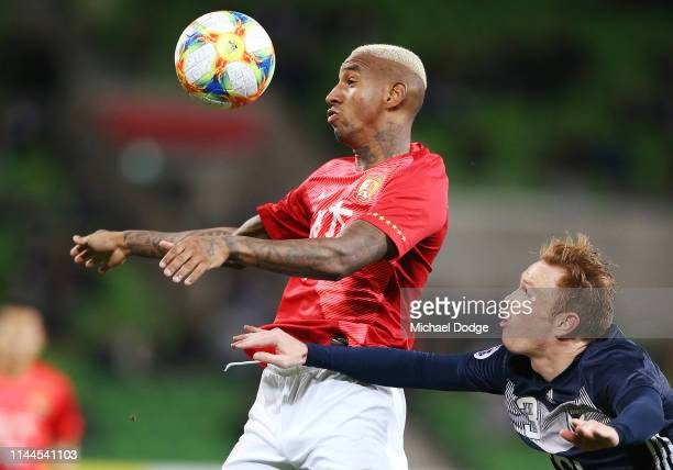Anderson Talisca of Guangzhou Evergrande heads the ball from Corey Brown of the Victory during the round 1 AFC Champions League Group F match between...