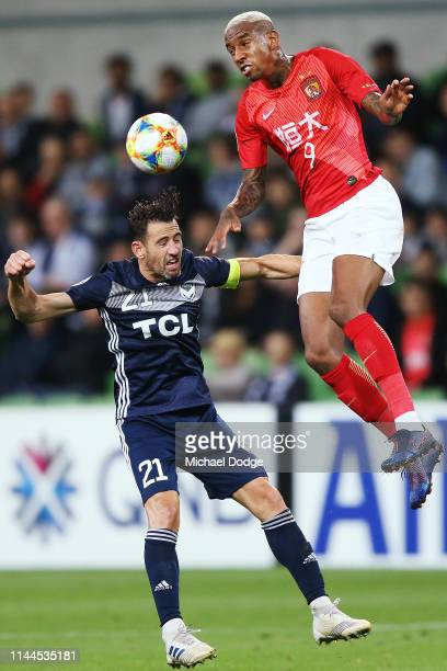 Anderson Talisca of Guangzhou Evergrande heads the Brisbane Lions over Carl Valeri of the Victory during the round 1 AFC Champions League Group F...