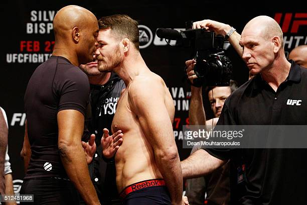 Anderson 'The Spider' Silva of Brazil and Michael 'The Count' Bisping of England come face to face and are held back by security during the UFC Fight...