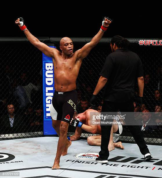 Anderson 'The Spider' Silva of Brazil turns in away in celebration thinking he has beaten Michael 'The Count' Bisping of England compete in their...