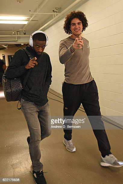 Anderson Varejao and Damian Jones of the Golden State Warriors arrive prior to a game against the New Orleans Pelicans at Smoothie King Center on...