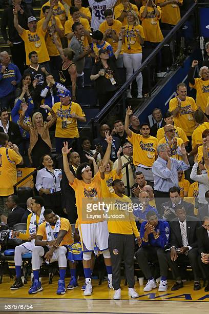 Anderson Varejao and Ian Clark of the Golden State Warriors celebrate a three point basket from the bench in Game Five of the Western Conference...