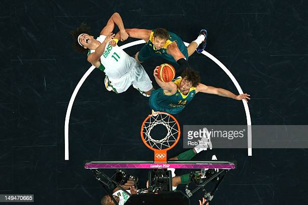 Anderson Varejao of Brazil gets fouled by David Andersen of Australia as Matt Nielsen goes for the rebound during their Men's Basketball Game on Day...