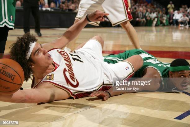Anderson Varejao of the Cleveland Cavaliers awaits the call from the official after he came away with the loose ball against Paul Pierce of the...
