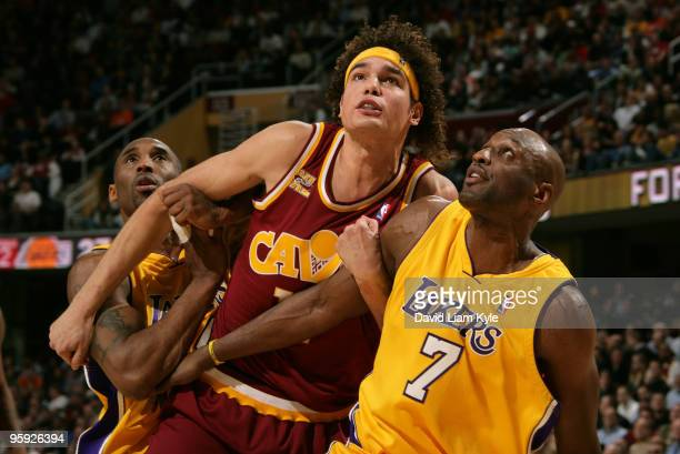 Anderson Varejao of the Cleveland Cavaliers battles for the rebound against Kobe Bryant and Lamar Odom of the Los Angeles Lakers on January 21 2010...