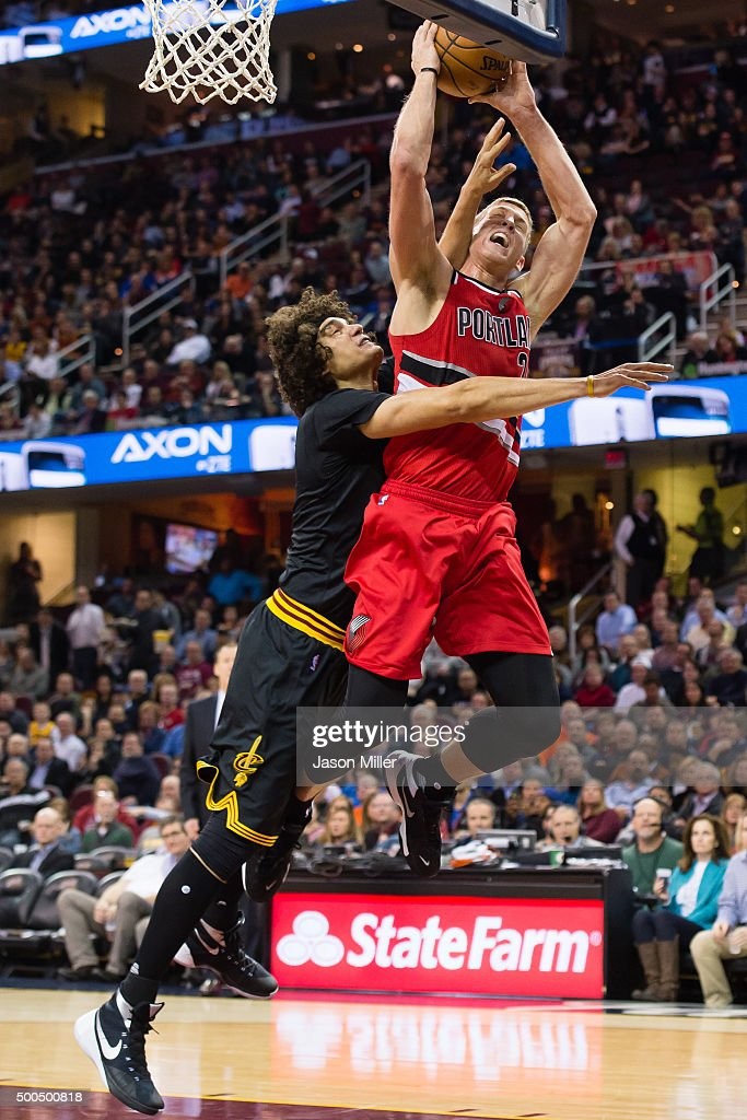 Anderson Varejao #17 of the Cleveland Cavaliers fouls Mason Plumlee #24 of the Portland Trail Blazers during the first half at Quicken Loans Arena on December 8, 2015 in Cleveland, Ohio.