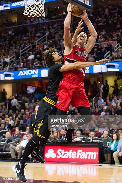 Anderson Varejao of the Cleveland Cavaliers fouls Mason Plumlee of the Portland Trail Blazers during the first half at Quicken Loans Arena on...