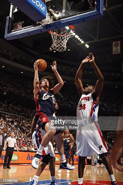 Anderson Varejao of the Cleveland Cavaliers goes up for a shot against Jason Maxiell of the Detroit Pistons in Game Five of the Eastern Conference...