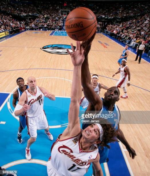 Anderson Varejao of the Cleveland Cavaliers goes up for the rebound against Tim Thomas of the Dallas Mavericks during a game at the American Airlines...