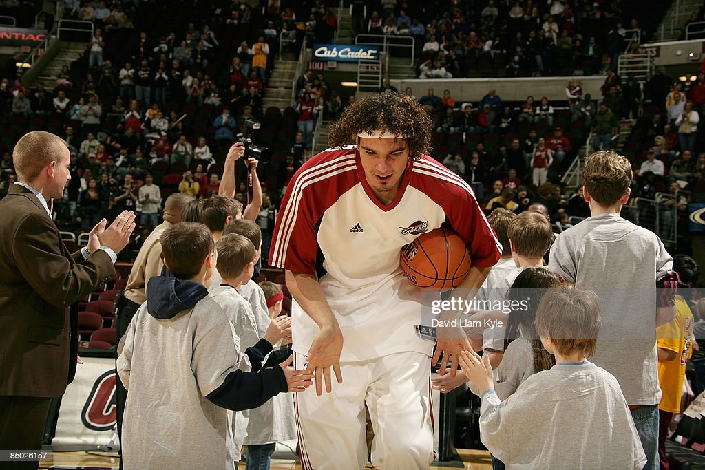 Anderson Varejao #17 of the Cleveland Cavaliers greets young fans before the game against the Sacramento Kings on January 27, 2009 at Quicken Loans Arena in Cleveland, Ohio. The Cavaliers won 117-110.