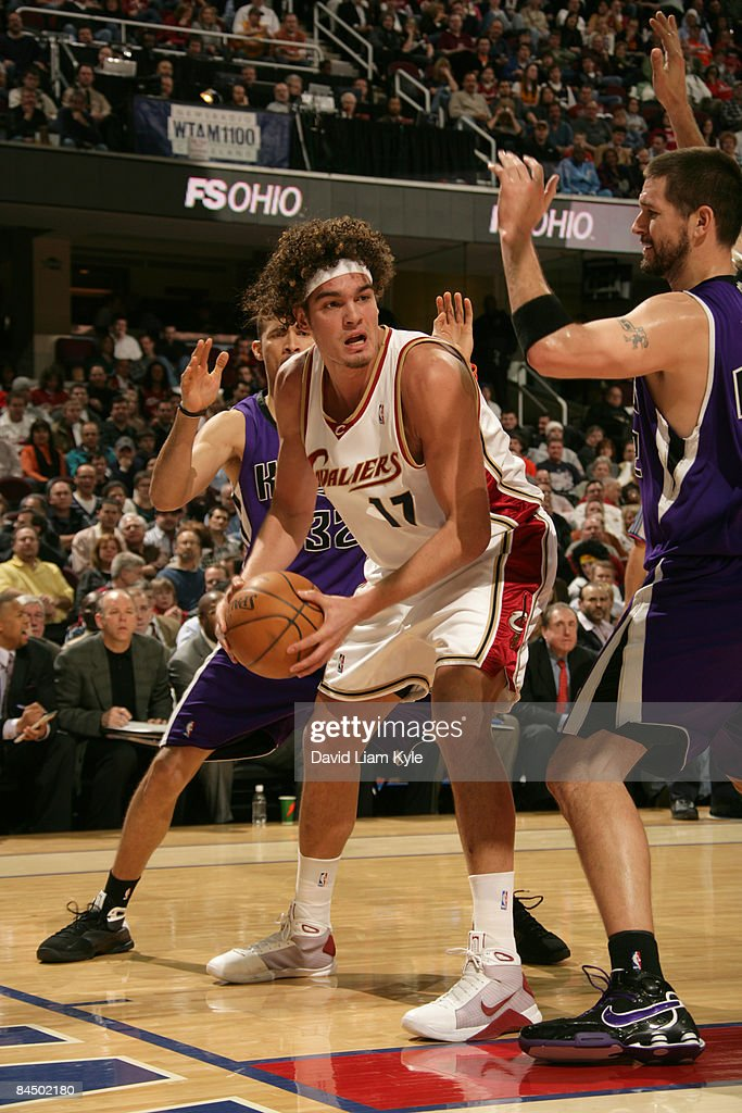 Anderson Varejao #17 of the Cleveland Cavaliers looks for an open teammate defended by Francisco Garcia #32 and Brad Miller #52 of the Sacramento Kings at The Quicken Loans Arena on January 27, 2009 in Cleveland, Ohio.