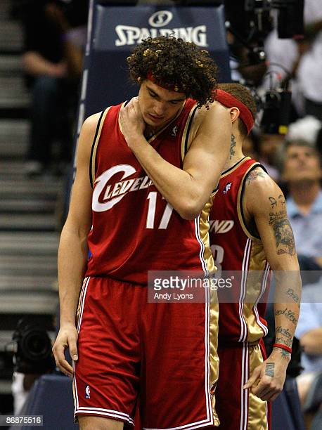 Anderson Varejao of the Cleveland Cavaliers rubs his neck and shoulder after getting fouled by the Atlanta Hawks in Game Three of the Eastern...