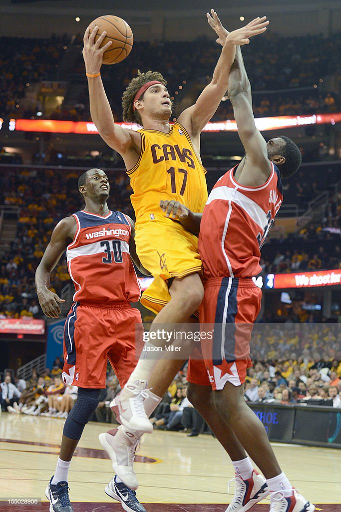 Anderson Varejao #17 of the Cleveland Cavaliers shoots over Earl Barron #30 and Chris Singleton #31 of the Washington Wizards during the second half at Quicken Loans Arena on October 30, 2012 in Cleveland, Ohio. The Cavaliers defeated the Wizards 94-84.