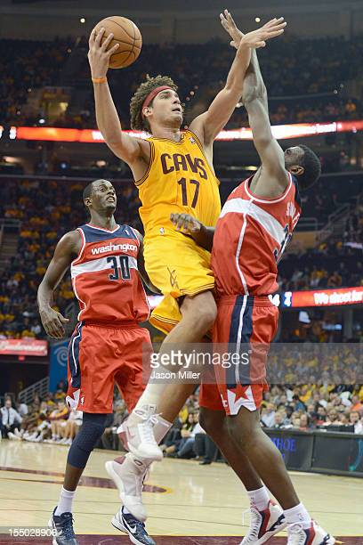 Anderson Varejao of the Cleveland Cavaliers shoots over Earl Barron and Chris Singleton of the Washington Wizards during the second half at Quicken...