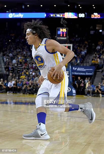 Anderson Varejao of the Golden State Warriors dribbles the ball against the Portland Trail Blazers during an NBA basketball game at ORACLE Arena on...