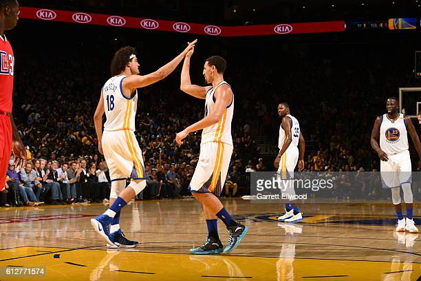 Anderson Varejao of the Golden State Warriors high fives Klay Thompson against the Los Angeles Clippers during a preseason game on October 4 2016 at...