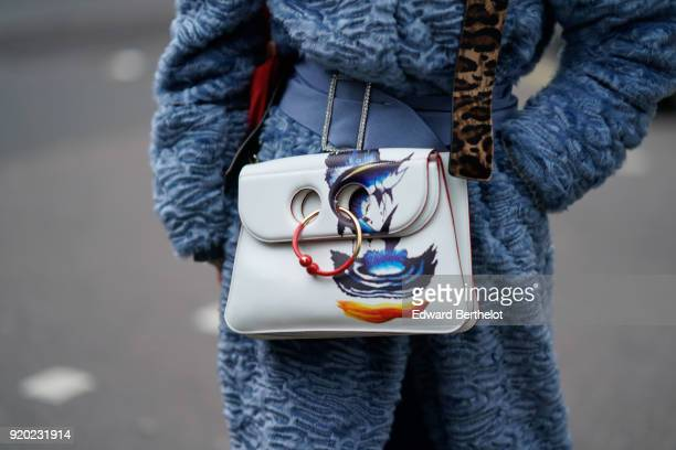 Anderson white bag with colored prints during London Fashion Week February 2018 on February 18 2018 in London England