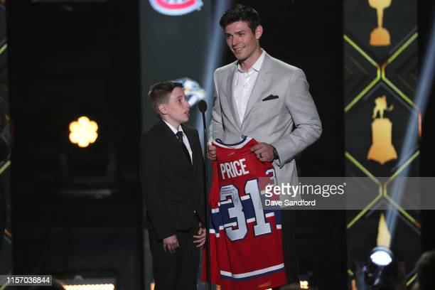 Anderson Whitehead and Carey Price of the Montreal Canadiens speak onstage during the 2019 NHL Awards at the Mandalay Bay Events Center on June 19...