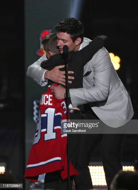 Anderson Whitehead gets a hug from Carey Price of the Montreal Canadiens onstage during the 2019 NHL Awards at the Mandalay Bay Events Center on June...