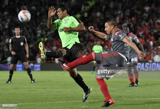 Anderson Zapata of America de Cali fights for the ball with Jose Sand of Deportivo Cali during the match between America de Cali and Deportivo Cali...