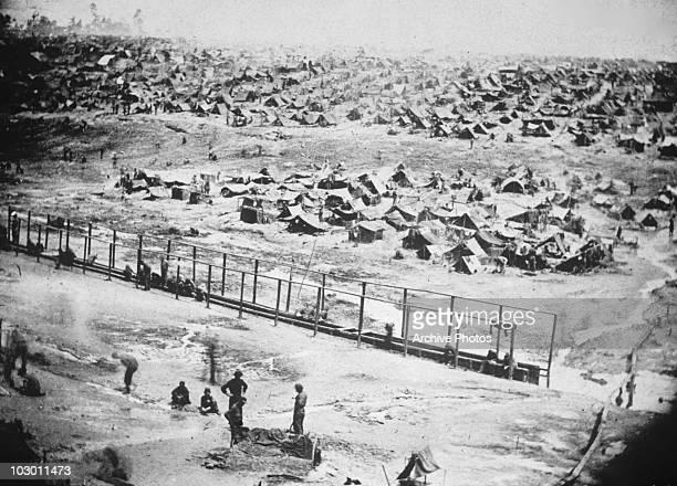 Andersonville Prison the Confederate prisonerofwar camp near Andersonville in southwestern Georgia USA circa 1865 Andersonville Prison was notorious...