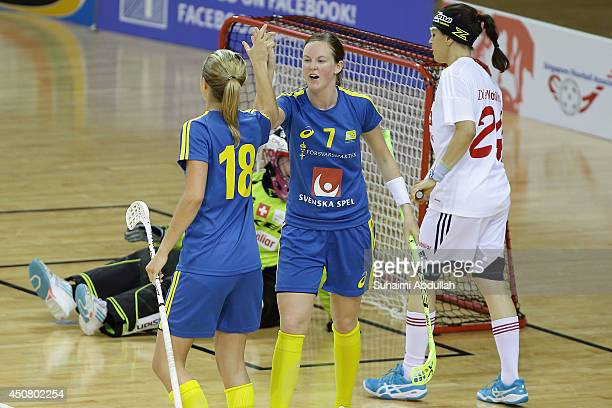 Andersson Erika and Larsson Julia of Sweden celebrates after scoring a goal during the World University Championship Floorball match between...