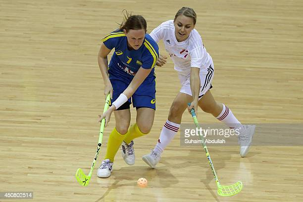 Andersson Erika of Sweden and Rahel Kaltenrieder of Switzerland challenge for the ball during the World University Championship Floorball match...