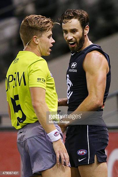 Andew Walker of the Blues reacts at the umpire after being penalised for throwing Angus Monfries of the Power into the fence during a tackle during...