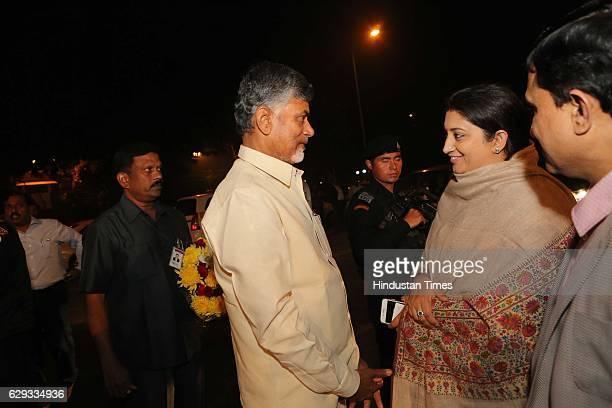 Andhra Pradesh Chief Minsiter N Chandrababu Naidu talking to Union Textile Minister Smriti Irani at the wedding reception of Union Minister Nitin...