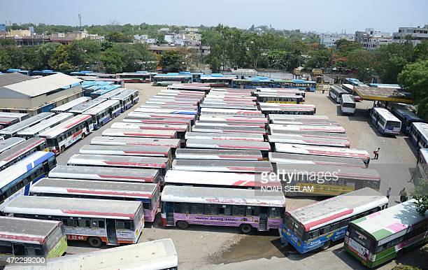 Andhra Pradesh State Road Transport Corporation buses stand parked at a bus depot in Hyderabad on May 6 during a strike called by drivers Employees...