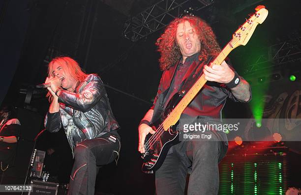 Andi Deris and Markus Grosskopf of Helloween performs on stage at HMV Forum on December 5 2010 in London England