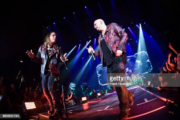 Andi Deris and Michael Kiske of the German band Helloween perform live on stage during a concert at the Tempodrom on December 4 2017 in Berlin Germany