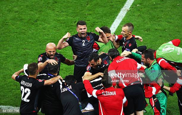 Andi Lila of Albania celebrates his team's first goal scored by Armando Sadiku with his team mates during the UEFA EURO 2016 Group A match between...