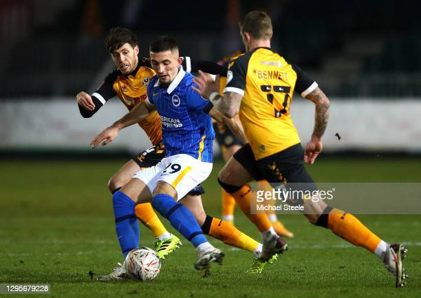 Andi Zeqiri of Brighton and Hove Albion passes the ball under pressure from Jamie Devitt and Scot Bennett of Newport County during the FA Cup Third...